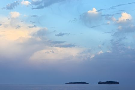 Sea landscape with two islands and beautiful turquoise sky photo