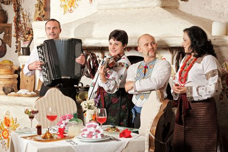concertina: Ukrainian ethnic music band concert in traditional restaurant interior Stock Photo