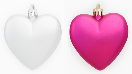 Two hearts Christmas decorations isolated on white photo