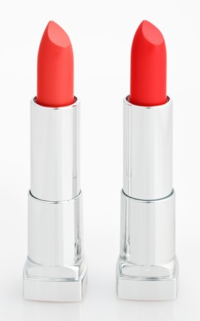Two red lipsticks isolated on white Stock Photo - 7319351