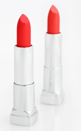 Two red lipsticks isolated on white photo