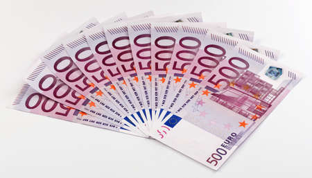 euromoney: 500 Euro bank notes fanned out on a white background