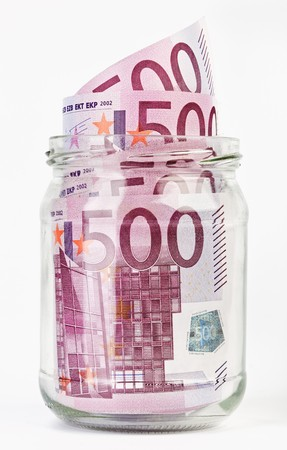 euromoney: 500 Euro bank notes in a glass jar isolated  on white background Stock Photo