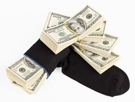 avidity: US dollars bundle hidden in black sock Stock Photo