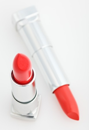 Two brown lipsticks isolated over white top view photo