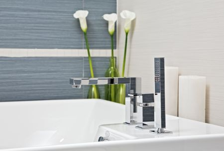 Part of modern bathroom in blue and gray tones with flowers Stock Photo