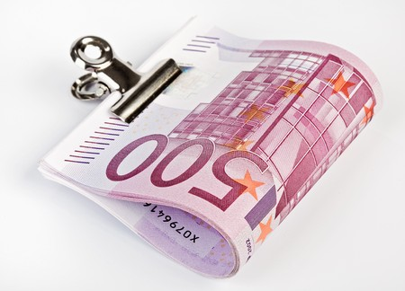 euromoney: Bundle of 500 Euro bank notes fasten with paper clip  isolated  on white background