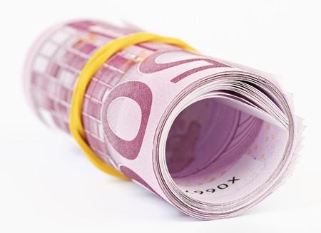 euromoney: 5 thousand Euro rolled up on white background
