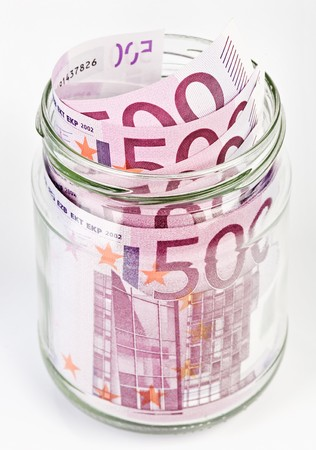 avidity: 500 Euro bank notes in a glass jar isolated  on white background Stock Photo