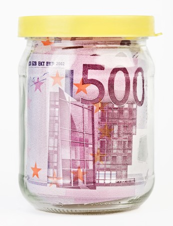 500 Euro bank notes in a glass jar isolated  on white background photo