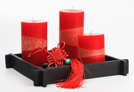 talisman: Chinese knots talisman, red candles and fancy pebble stones in a black box Stock Photo