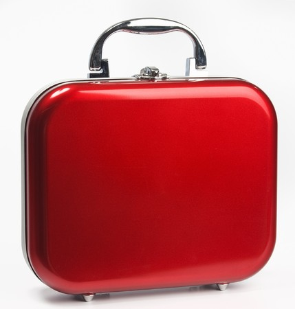 A glossy red suitcase with rounded corners and silvery details Stock Photo - 7326912