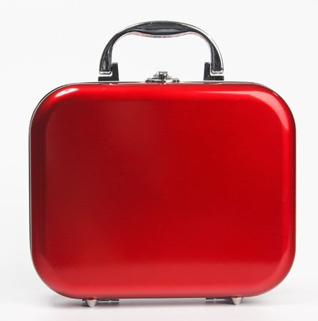 A glossy red suitcase with rounded corners and silvery details photo