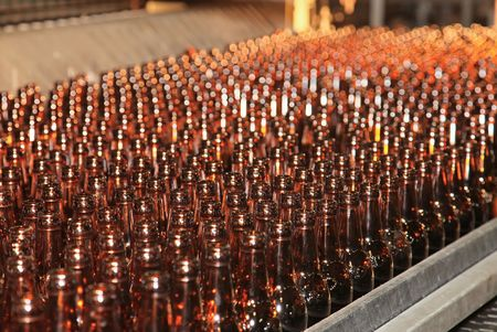 Conveyer line with many beer bottles Stock Photo - 7350489