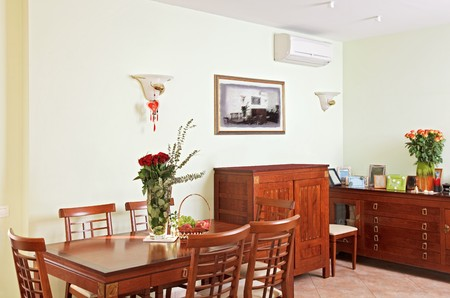 Dining room interior with classic wooden furniture photo