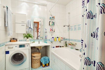 Laundry room: Modern small bathroom in blue colors wide angle view