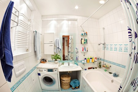 small basket: Modern small bathroom in blue colors wide angle view