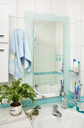 Part of small modern bathroom interior with mirror  photo