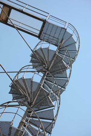 Metal spiral stairs in front of blue sky Stock Photo - 7409423