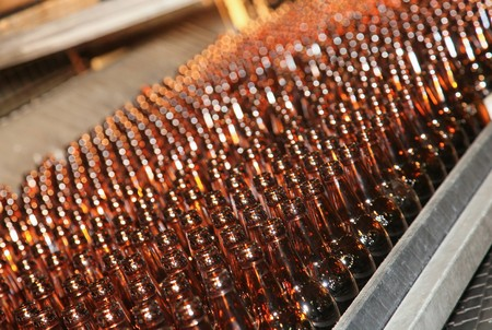 Conveyer line with many beer bottles Stock Photo - 7409416