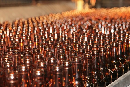 Conveyer line with many beer bottles Stock Photo - 7409414