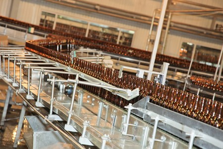 Conveyer line with many beer bottles Stock Photo - 7427733