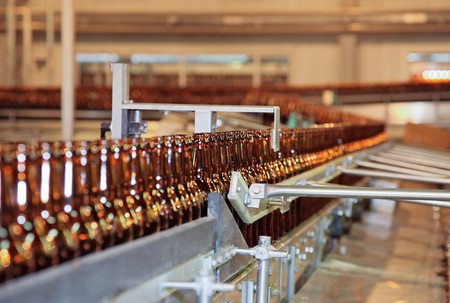 Conveyer line with many beer bottles Stock Photo - 7409355