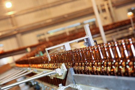 conveyer: Conveyer line with many beer bottles