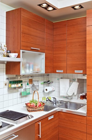 Part of Kitchen interior with wooden furniture and sink photo