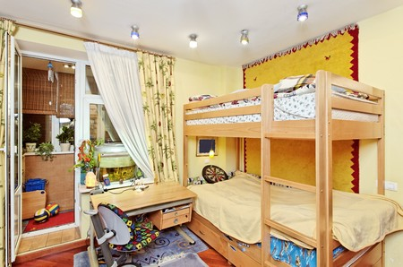 Nursery room interior with two-high wooden bed Stock Photo - 7441443