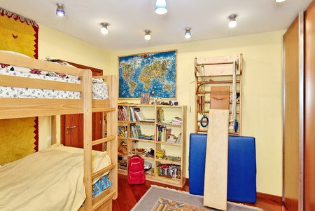 Nursery room interior with two-high wooden bed photo