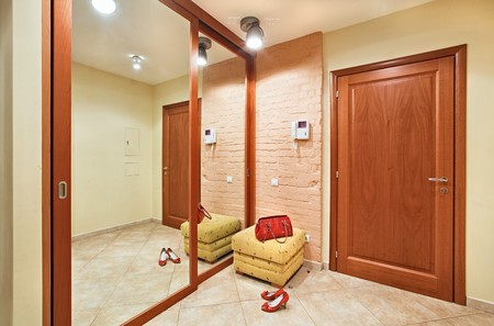 Elegance anteroom interior in warm tones with hallstand and mirror photo