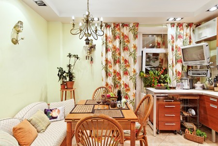 Kitchen inter with wooden furniture, table and many utensils in warm tones on wide angle view Stock Photo - 7478640
