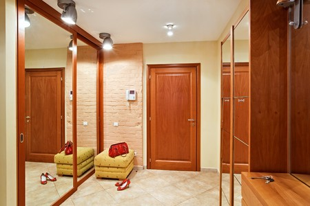 Elegance anteroom interior in warm tones with hallstand and mirror