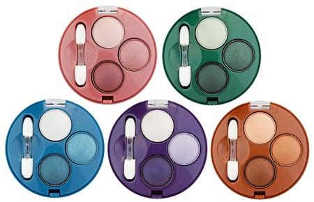 Set of 5 multicolored eye shadows isolated on white photo
