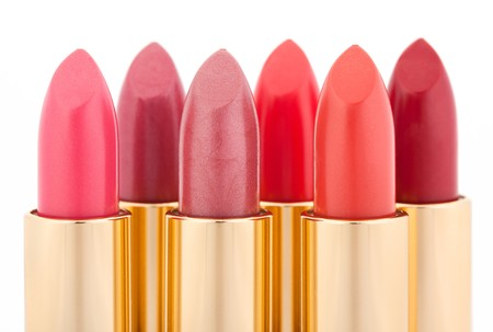 Multicolored color lipsticks arranged in two lines isolated on white, shallow depth of field photo