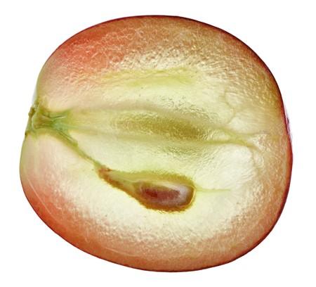 Translucent slice of red grape fruit, macro isolated on white photo
