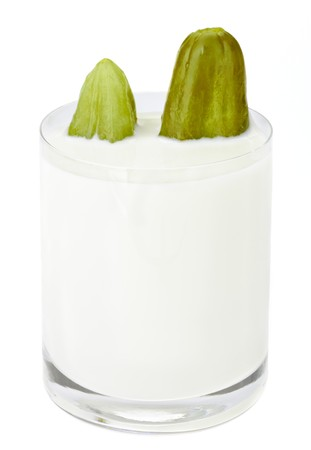 incompatible: Incompatible eating products milk and salted cucumber Stock Photo
