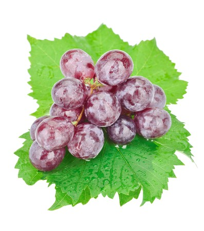 Bunch of red grapes with water drops isolated on white photo