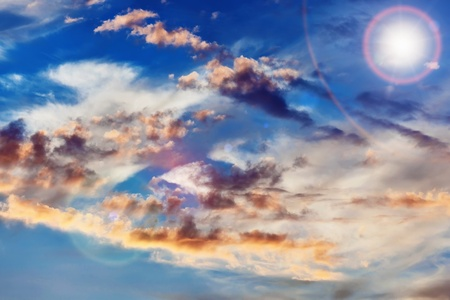 Cumulus clouds on sunset sky background photo