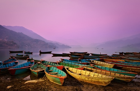 Beautiful twilight landscape with boats on Phewa lake, Pokhara, Nepal Stock Photo