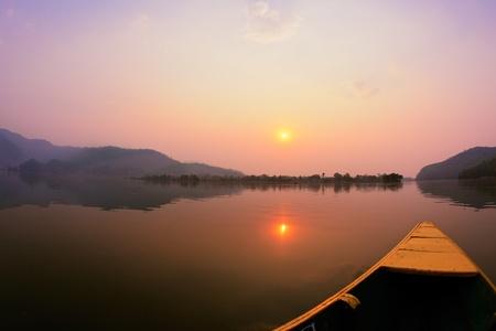 Beautiful sunrise landscape from boat view on Phewa lake, Pokhara, Nepal photo