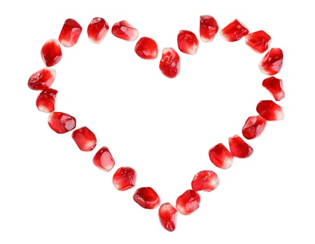 incarnadine: Heart symbol made from pomegranate seeds isolated on white background