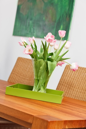 Bouquet of pink tulips flowers in glass vase on wooden table Stock Photo - 8547638