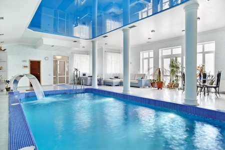 Indoor big blue swimming pool interior in modern minimalism style