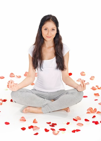 Young beautiful woman meditating in lotus pose Stock Photo - 8547278