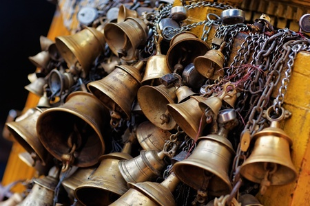 cupper: Many metal sacrificial bells hanging on chain, Kathmandu, Nepal Stock Photo