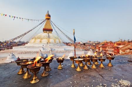 stupas: Many sacred candles in front of Boudha Nath (Bodhnath) stupa in kathmandu, Nepal