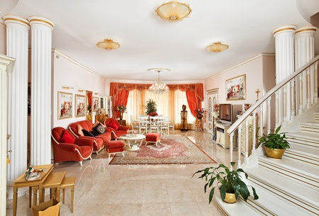 Classic style drawing-room interior in red and golden colors, view from hall Stock Photo