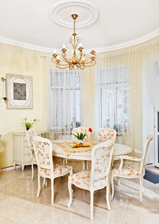 Classic style dining room interior in beige pastoral colors photo
